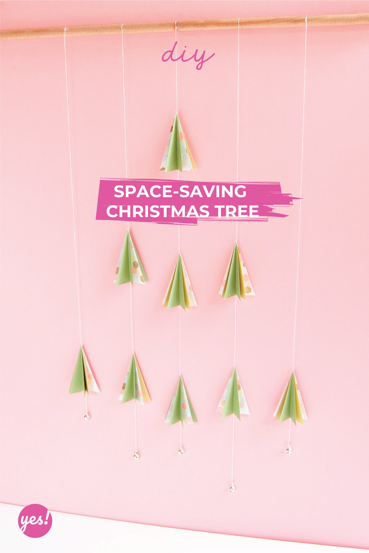 Space Saving Christmas Tree - DIY - Made of paper and thread, this beautiful Christmas tree is perfect for small spaces - www.yeswemadethis.com
