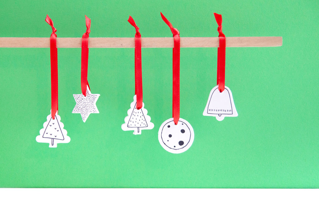 White Clay Christmas Ornaments - DIY - Lovely ornaments made of white modeling clay and decorated with a sharpie. Super simple! - www.yeswemadethis.com