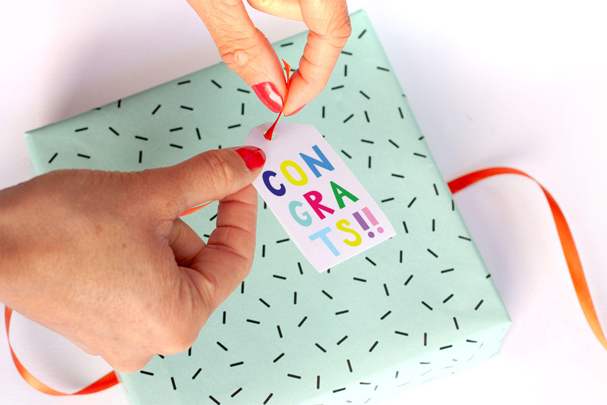 Attaching a Gift Tag on Present