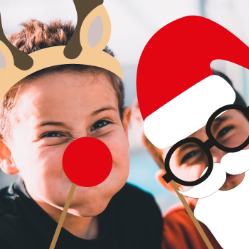 Two boys with Xmas photo props